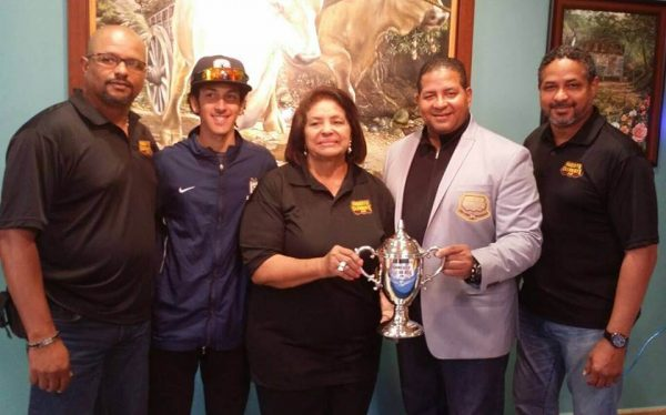 The Clemente Family holding the Clemente Cup.