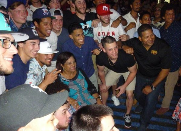 "The SUNY Canton Kangaroos Baseball team with Mrs. Clemente and family shortly after singing ""Happy Birthday"" to her.  Included in this photo are Luis Caballero, Gerald Abillar, Christopher Lee, Vinny Bondinello, Cristian Cruz, Wilson Matos, myself, Axel Riviere, Erdous Lebron, Derrick Machado, Travis Bigelow, Greg Dobies, Travis Schindler, and Dan Coant as well as Luis and Vera Clemente. (Photo by Fred Saburro)"